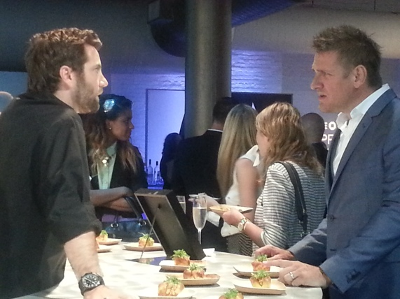 "Curtis Stone and contestant Marcel Vigneron talk shop over Vigneron's lobster-based ""Knuckle Sandwiches."""